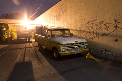 1966 Ford Truck (Curtis Gregory Perry) Tags: portland oregon 1966 ford truck night pickup longexposure graffiti light fence wall brick parking lot nikon d800e lens flare barf