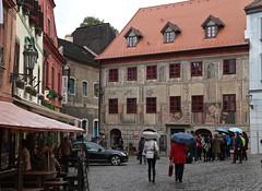 Painted Facades 02 (smilla4) Tags: architecture rain umbrellas paintedfacades medievalcity ceskykrumlov czechrepublic