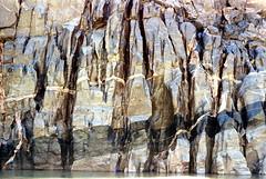 35-754 (ndpa / s. lundeen, archivist) Tags: nick dewolf nickdewolf color photographbynickdewolf 1970s 1973 1972 film 35mm 35 reel35 arizona northernarizona southwesternunitedstates canyon marblecanyon grandcanyon coloradoriver raftingtrip raftingexpedition rafting river riverrafting rock rocks rocky canyonwall canyonwalls watersedge riversedge erosion stratification
