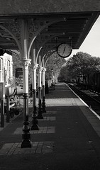 Black and white (madmax557) Tags: nvr railwaystations railway ferrymeadow uk peterborough eastanglia england railwayplatform clock blackwhite cambridgeshire trees