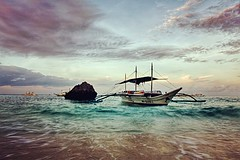 The illusion of balance~ Boracay (~mimo~) Tags: landscape travel longexposure ocean sunrise boat beach philippines boracay