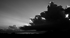 Throwing out sunbeams (momrunninglate) Tags: stormclouds clouds blackandwhite contrast dramatic sky weather landscape silhouette kansas