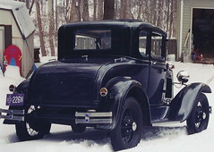 Boris in snow (austexican718) Tags: ford antique veteran vintage classic car snow weather reflection auto automobile coupe contrast skinnytires wirewheels