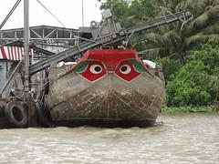 Stop looking at me swan! (program monkey) Tags: vietnam mekong river delta cargo boat ben tre tra vinh loading machine eyes dock