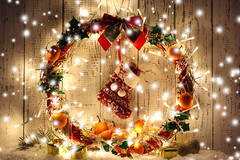 Beautiful Christmas wreath, on wooden background (uomo1808) Tags: background balls beautiful bow celebrating celebration christmas circle dark decor decorate decoration decorative design door element fir garland gold golden green holiday leaf leaves light lights mistletoe new night orange plant red ribbon santa snow sock tangerine tangerines tradition traditional tree wooden wreath xmas year ukraine alumbradonavideo