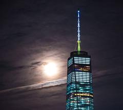 Symbol of Hope (Sid's Corner) Tags: green skyscrapers skyline freedomtower nyc newyork newyorkcity panorama sunset cityscape city usa nikon nikond800 wtc evening red orangesky schoksi schoksiphotography ngc worldtradecenter nj newjersey 911 nightphotography exchangeplace streetphotography nightscape