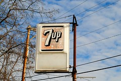 1950's 7up logo, Milford Wisconsin (Cragin Spring) Tags: sign 7up vintage plastic soda sodapop pop lemonlime wisconsin wi midwest unitedstates usa unitedstatesofamerica rural logo milford milfordwisconsin milfordwi softdrink pole sky clouds