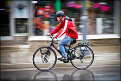 Red Rain Jacket (Dan Dewan) Tags: street red ontario colour reflection rain bicycle cyclist ottawa streetphoto colourful panning ideas bankstreet photographist canoneos7d canonefs18135mmf3556is dandewan