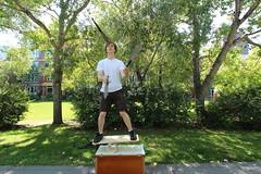 The knife juggler Downtown Calgary (davebloggs007) Tags: calgary river eau clare market knife bow juggler pathway