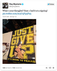 "Rey Mysterio tweets a fan-made ""Just Give Up"" sign"