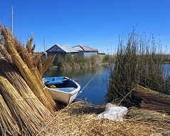 Rowboat and Sheaves of Reeds, Uros, Lake Titicaca (Mike Colyer) Tags: uros reeds island boat cathedral floating taquile puno yavari