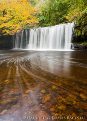 Golden Water fall (LongLensPhotography.co.uk - Daugirdas Tomas Racys) Tags: longexposure autumn trees orange cliff brown white mountain color green fall nature water leaves yellow wales river flow golden waterfall nationalpark october rocks colours walk low wide trails hike falls breconbeacons fluid upper valley translucent swirl welsh transparent burst streaks liquid current folliage pontneddfechan neath neddfechan sgwdddwlli