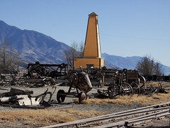 Scattered in the Yard (lefeber) Tags: california railroad homes mountains architecture town rust traintracks roadtrip shops depot railyard ruraldecay laws farmequipment owensvalley railroadtracks aerialperspective rustymetal