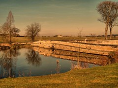 The Golden Hour (saxonfenken) Tags: bridge trees sunset reflections golden pond dusk storybook gamewinner 7044 challengeyouwinner blatherwyke pregamesweepwinner 7044bridge