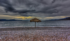 A lonely umbrella is waiting for the summer (Vagelis Pikoulas) Tags: blue trees light sunset sea sky sun mountain mountains west colour reflection tree beach rock clouds umbrella canon landscape eos kiss rocks europe day waves niceshot view cloudy greece western 1855mm hdr x4 2014 attiki vilia 550d abigfave colorphotoaward bestcapturesaoi mygearandme mygearandmepremium mygearandmebronze mygearandmesilver mygearandmegold mygearandmeplatinum ringexcellence musictomyeyeslevel1