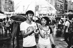 We hold hands (Jimmy C. Yang) Tags: people blackandwhite rain expression flash streetphotography streetportrait snap   ximending holdhands  fujifilmx100 yang1219