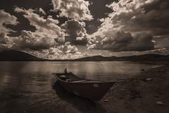 (nadiaorioliphoto) Tags: boat lake clouds nuvole sky barca lago cielo skyline monocromo water acqua campotosto