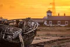 Golden horizon (James Waghorn) Tags: wreck autumn beach dungeness textures sunset tamronsp70300f456vcusd pebbles railway boat kent d7100 clouds england solitary alone decay abandoned pylon gold