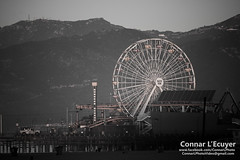 Spinning Uselessly (Connar L'Ecuyer) Tags: socal peoplewatching beach sunrise ocean pier wharf cityscape city streetphotography street santamonica people la
