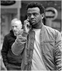 Pink Shirt (1980blue Street) Tags: street candid mono monochrome blackandwhite cardiff queenstreet autumn boy man guy bloke black