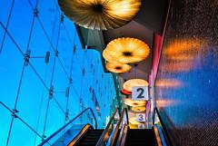 Levels (Carrie McGann) Tags: beverlycenter losangeles beverlygrove escalator lights umbrellas sky windows 050416 nikon interesting