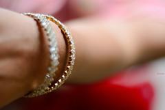 ~bangles~ ([s e l v i n]) Tags: beautiful beauty fashion 50mm gold dof hand skin fashionphotography ss style jewellery ornament ornaments desi bangles indianjewellery 50mmprime primelens choodiyan indianfashion desifashion selvin