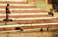 The ritual bath in the morning (Captivating World) Tags: travel vacation india man water stairs river person construction asia object religion steps bank varanasi ritual bathing ganges