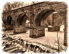 Berea bridges over ice capped Rocky River (SteveMather) Tags: winter ohio snow abandoned water rock stone sepia frozen sandstone december arch lakeerie dam grunge iii cleveland bridges arches oh 4s iphone buttress berea rockyriver metroparks buttresses arched rockyriverreservation 2013 buttressed topazadjust greatlakeswatershed stephenrmather dxoviewpoint2 dxoopticspro91