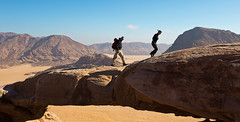 Burdah rock and Burdah rock bridge, Wadi Rum, Jordan (Miche & Jon Rousell) Tags: blue red sky cloud yellow sand rocks desert wadirum cliffs jordan sanddune rockbridge burdah burdahrockbridge