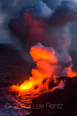 Molten Lava Hissing into the Pacific Ocean off the Big Island of Hawaii (Lee Rentz) Tags: ocean red sea orange usa hot water rock night clouds america reflections vent reflecting kalapana volcano hawaii lava evening twilight waves glow hell entrance surface steam reflected pacificocean elements land glowing flowing bigisland geology volcanic eruption entering kilauea collide crashing collision steaming puna hiss reddish elemental billowing lavafield geological forming hissing lavaflow puuoo geologic punadistrict entrypoint eastriftzone kilauealavaflow {vision}:{sunset}=078 {vision}:{sky}=0956 {vision}:{clouds}=0678