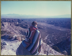 The Watcher. (goddamnanalog) Tags: newmexico southwest color nature girl landscape polaroid view desert blanket 4x5 largeformat watcher polaroidweek polaroid59 roidweek polaweek roidweek14