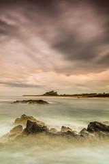Bamburgh Castle (Squareburn) Tags: longexposure seascape castle coast northumberland bamburgh bamburghcastle