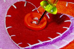 """the stitch into the (stitched) heart (for macro mondays """"stitch"""") (Herr Nergal) Tags: stitch macro mondays table top color heart stitched macromondays makro needle red"""