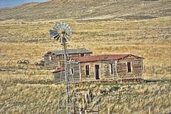 In Times Like This (RootsRunDeep) Tags: windmill old decay abandoned heritage homestead log wooden wagon wheels farm ranch sagebrush wyoming rust ruin