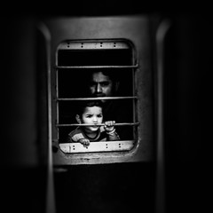 Freedom Of Soul !!! (mithila909) Tags: streetphotography children man window grill concept train