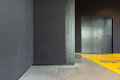 Corridor (genf) Tags: corridor lift elevator gang yellow geel grey gray grijs lines planes shapes walls muren vlakken vormen sony a77 sigma 1835f18 abstract indoor militair museum military soesterberg