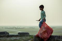The young boy! (Ajwad Mohimin) Tags: boy child bangladesh bangladeshi beach dusk boat job mist fog canon canonphotos ngc