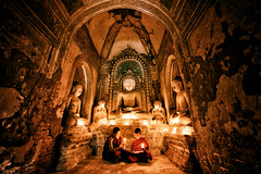 Holy Room (Michael S Liu) Tags: figures wideangle buddhism building statue buddah ultrawide candlelight lighting bagan myanmar monks temple children praying