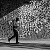lots of dots (jimATL (weltreisender2000)) Tags: man walking smartphone eastside beltline wall art mural hense dots shadows bw blackandwhite atlanta explored