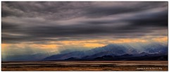 Panamint Mountains - Clearing Storm 1 (GlixPix) Tags: california panorama cloud mountain storm mountains art beautiful clouds landscape nationalpark desert dramatic olympus wash highdesert rainstorm deathvalley thunderstorm badlands sunrays drama thunderclouds e30 cloudysky stormclouds topaz winterstorm thunderheads desertmountains clearingstorm landscapeportrait olympuse30 zd918mm glixpix kevindrenz kevinrenz kdrenz zuiko918mmf4superwide