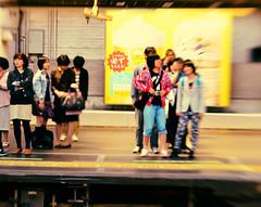 annoyance in tokyo (meeeeeeeeeel) Tags: city trip travel people urban distortion japan lensbaby subway tokyo blurry shinjuku asia metro candid transports