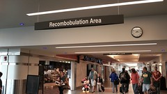 MKE Recombobulation Area (Lynn Friedman) Tags: ca usa clock fashion sign wisconsin airport gate published gates c security terminal passengers packers milwaukee area arrival minniemouse departure wi c9 checkpoint c25 mke attribution terminalc lynnfriedman recombobulation lynnrfriedman