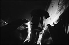19th St. BART (icki) Tags: california ca street blackandwhite rain night umbrella oakland downtown 19thstbartstation november2013