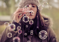 I'm Forever Blowing Bubbles (Ruthie H) Tags: winter portrait woman selfportrait hat self fun toy soap adult pentax coat floating bubbles k5 selfie pentaxsmcda50135
