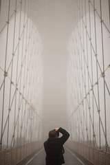 Brooklyn Cathedral. (Vitaliy P.) Tags: street new york city nyc bridge man fog brooklyn back warm photographer manhattan f14 candid empty 85mm sigma brooklynbridge gothamist d600 vitaliypiltser vitaliyp