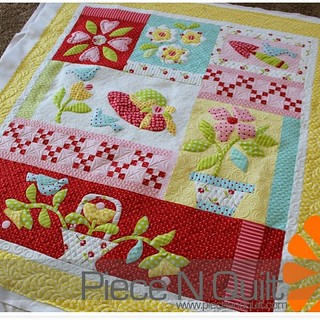 Cheryls adorable quilt is on the blog! Love how bright and cheery this quilt is! www.pieceandquilt.com #piecenquilt #freemotionquilting #longarmquilting #gammill #battgirls @obxcheryl