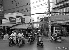 Four Abreast (Dion Cragg) Tags: portrait blackandwhite bike asian blackwhite asia vietnamese bbw streetphotography vietnam motorbike cables saigon hochiminhcity hmc hochiminh asianportraits