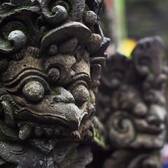 bird-like guardian (e h s a n) Tags: travel bali statue indonesia stonecarving olympus manualfocus omd travelphotography m43 rokkor em5 tirthaempul microfourthird minoltamcrokkorxpg50mmf14