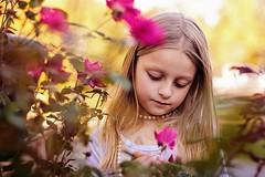 Nature Lover (Teresa Ramella) Tags: child girl outdoors outside flowers littlegirl