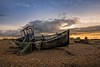 Draped (James Waghorn) Tags: sigma1020f456 autumn beach net d7100 derelict topazclarity wreck pebbles boat sunset kent dungeness clouds alone bleak abandoned england